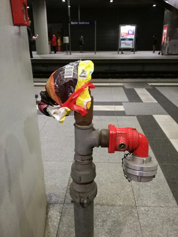 Plastic bag repairment of leaking Deutsche Bahn fire hydrant