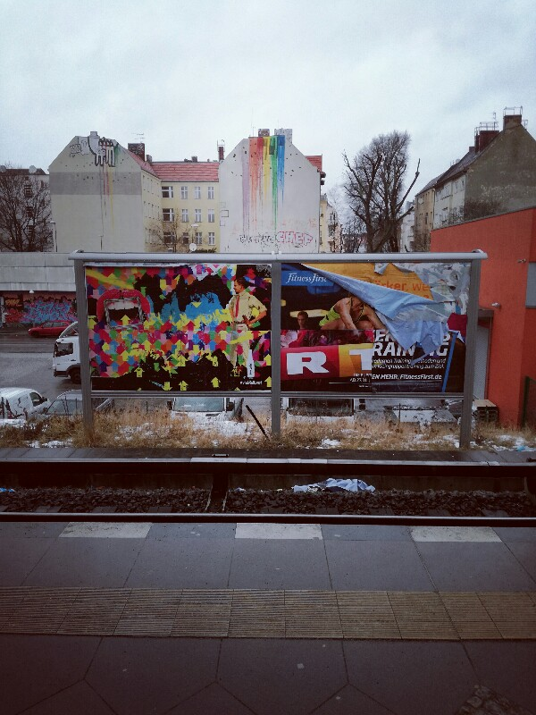 Streetart and advertising posters at trainstation Berlin Neukölln by Stefan Klenke