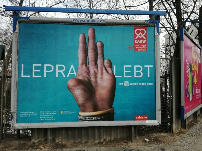 Street photo of poster for the Lepra Lebt campaign - Berlin Treptow (Photo by Stefan Klenke)