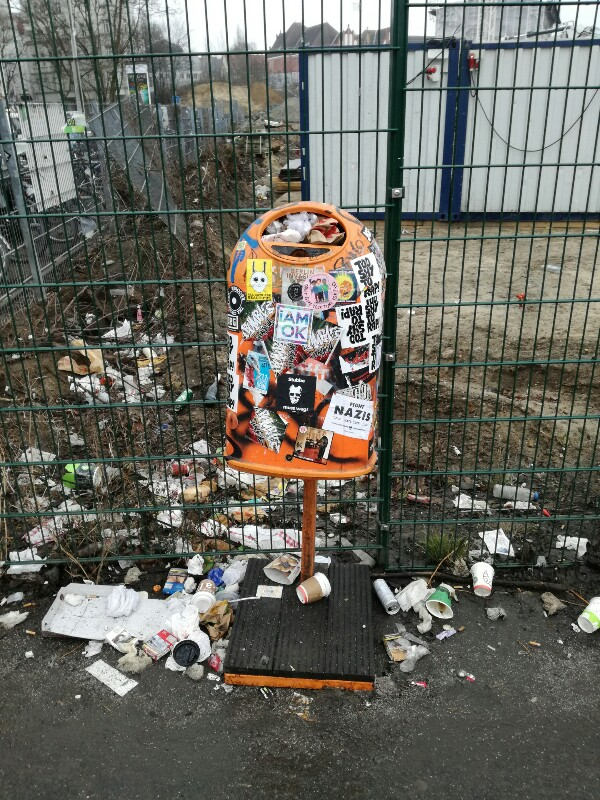 Streetphoto of a messy stickercovered bin near Berlin Ostkreuz, by Stefan Klenke